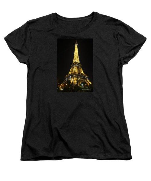 The Eiffel Tower At Night Illuminated, Paris, France. Women's T-Shirt (Standard Cut) by Perry Van Munster