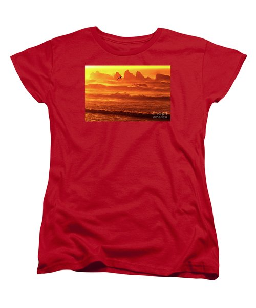 Women's T-Shirt (Standard Cut) featuring the photograph Seagull Soaring Over The Surf At Sunset Oregon Coast by Dave Welling