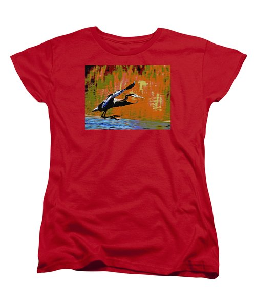 The Great Blue Heron Jumps To Flight Women's T-Shirt (Standard Cut) by Tom Janca