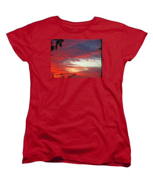 Women's T-Shirt (Standard Cut) featuring the photograph Papaya Colored Sunset With Geese by Kym Backland