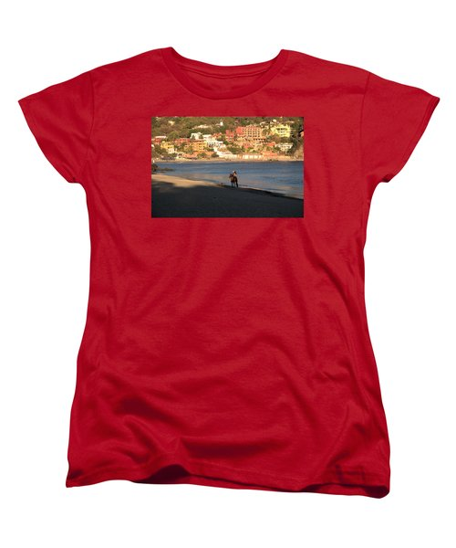 Women's T-Shirt (Standard Cut) featuring the photograph A Ride On The Beach by Jim Walls PhotoArtist
