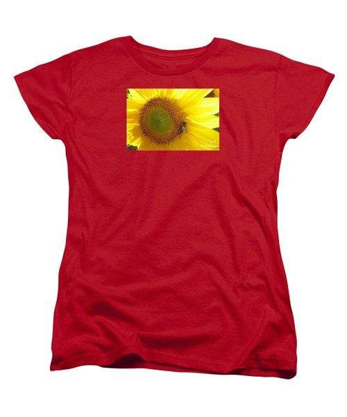 Women's T-Shirt (Standard Cut) featuring the photograph Bee On Sunflower by Jean Bernard Roussilhe