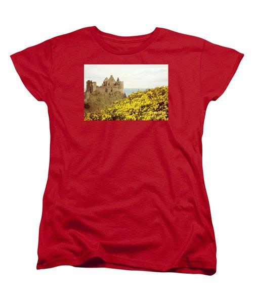 Women's T-Shirt (Standard Cut) featuring the photograph Castle Ruins And Yellow Wildflowers Along The Irish Coast by Juli Scalzi