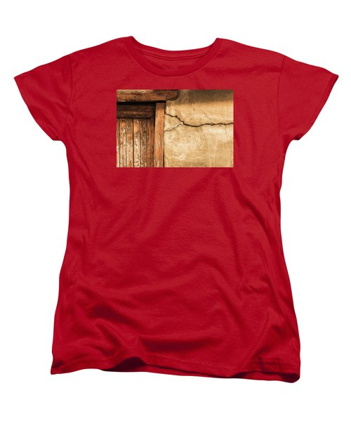 Women's T-Shirt (Standard Cut) featuring the photograph Cracked Lime Stone Wall And Detail Of An Old Wooden Door by Semmick Photo
