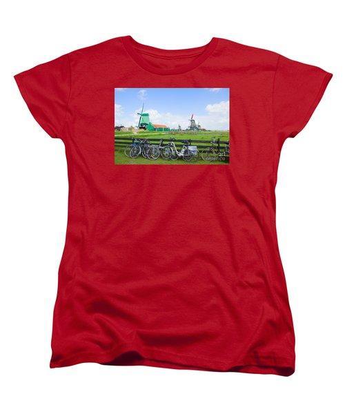dutch windmills with bikes in Zaanse Schans Women's T-Shirt (Standard Cut) by Anastasy Yarmolovich