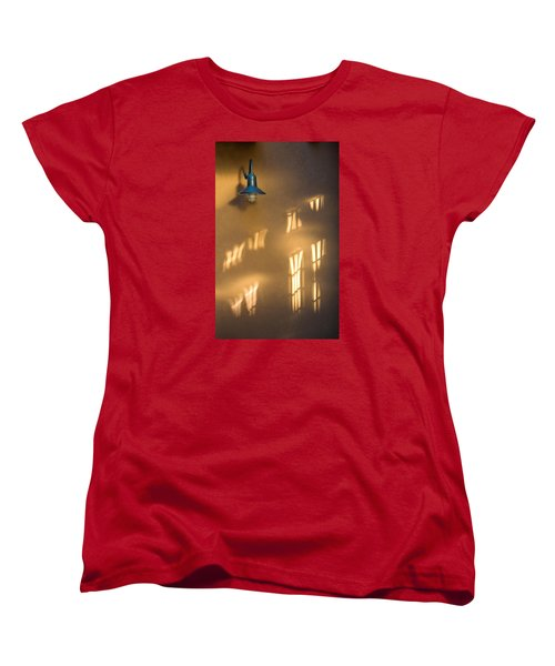 Lonely Lamp Among Sunrise Window Light Reflections Women's T-Shirt (Standard Cut) by Gary Slawsky