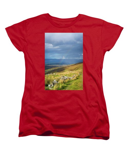 Women's T-Shirt (Standard Cut) featuring the photograph Sunshine And Raining Down With Rainbow On The Countryside In Ire by Semmick Photo