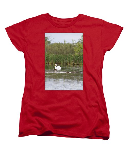 Women's T-Shirt (Standard Cut) featuring the photograph The Pelican And The Ducklings by Alyce Taylor