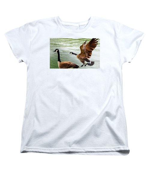 Women's T-Shirt (Standard Cut) featuring the photograph A Pair Of Canada Geese Landing On Rockland Lake by Jerry Cowart