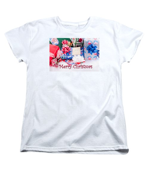 Women's T-Shirt (Standard Cut) featuring the photograph Christmas Presents On Artificial Snow by Vizual Studio