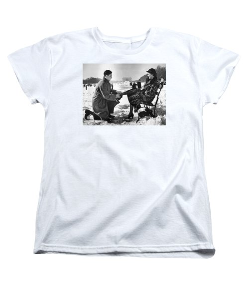Man Lends A Helping Hand To Put On Skates Women's T-Shirt (Standard Cut) by Underwood Archives