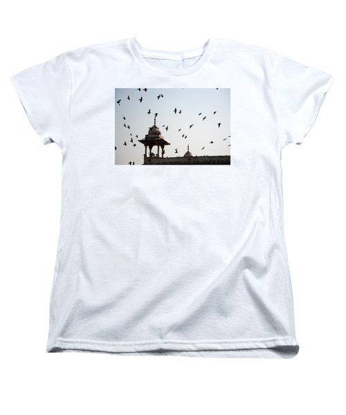 Women's T-Shirt (Standard Cut) featuring the photograph A Whole Flock Of Pigeons On The Top Of The Ramparts Of The Red Fort In New Delhi by Ashish Agarwal