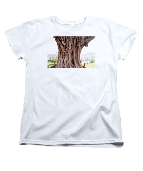 Women's T-Shirt (Standard Cut) featuring the photograph The Twisted And Gnarled Stump And Stem Of A Large Tree Inside The Qutub Minar Compound by Ashish Agarwal