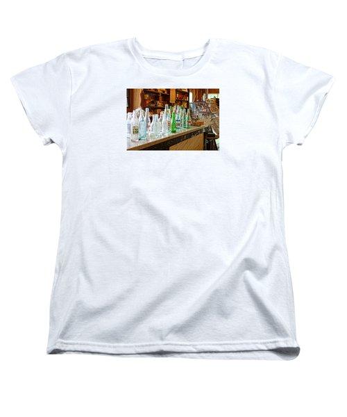At The Store Women's T-Shirt (Standard Cut) by Steven Clipperton