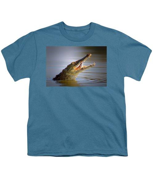 Nile Crocodile Swollowing Fish Youth T-Shirt by Johan Swanepoel