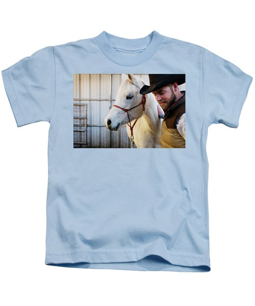 A Male Ranch Hand In A Cowboy Hat Kids T-Shirt
