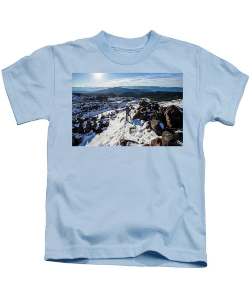 A Climber Moves Uphill Through The Snow Kids T-Shirt