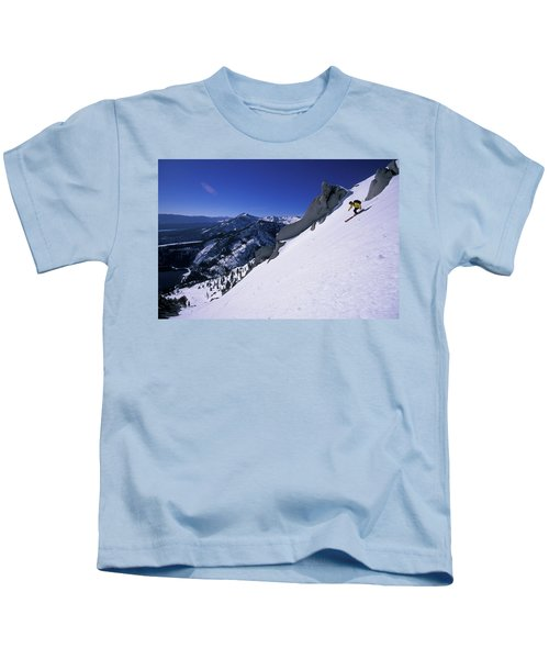 A Man Backcountry Skiing In A Remote Kids T-Shirt