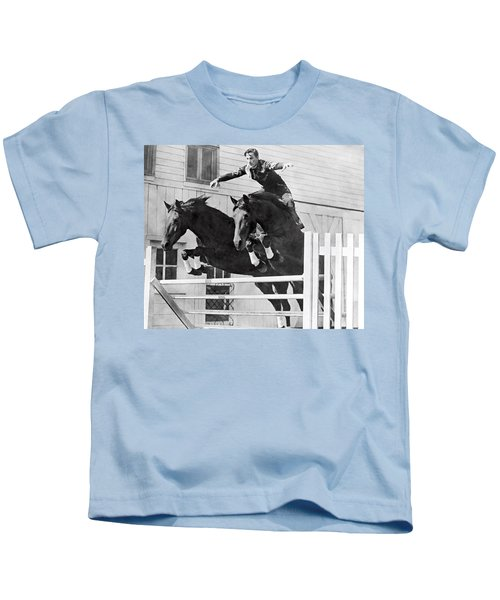 A Stunt Rider On Two Horses. Kids T-Shirt