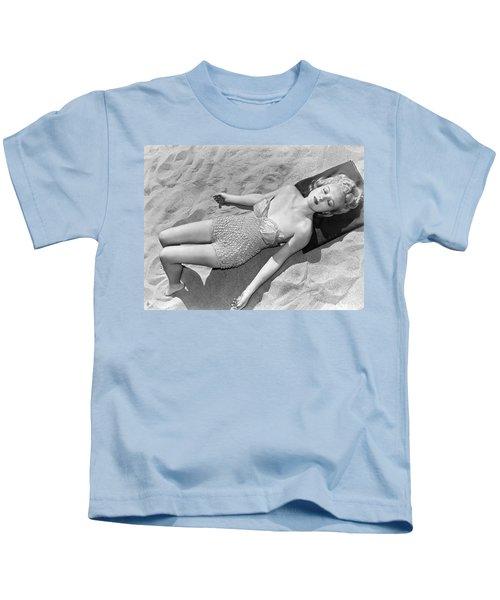 Woman Sun Bathing At The Beach Kids T-Shirt