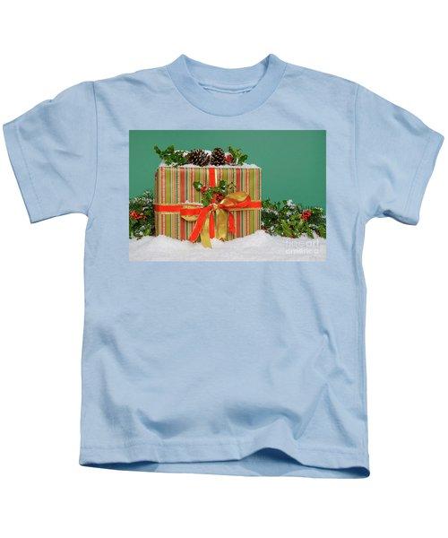 Christmas Present On Snow Green Background Kids T-Shirt