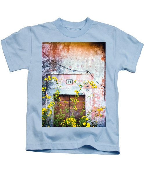 Yellow Flowers And Decayed Wall Kids T-Shirt