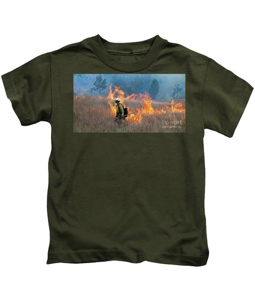 A Firefighter Ignites The Norbeck Prescribed Fire. Kids T-Shirt