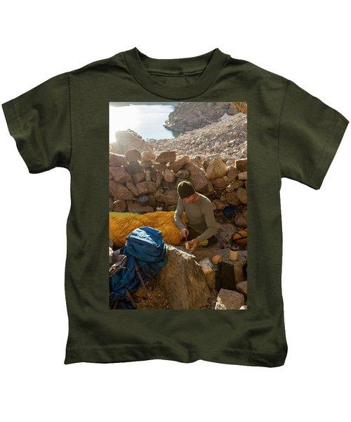A Male Mountain Climber Getting Ready Kids T-Shirt