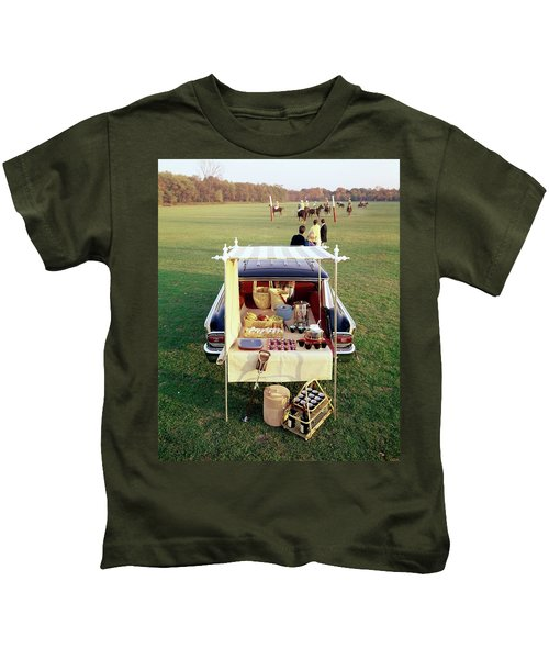 A Picnic Table Set Up On The Back Of A Car Kids T-Shirt