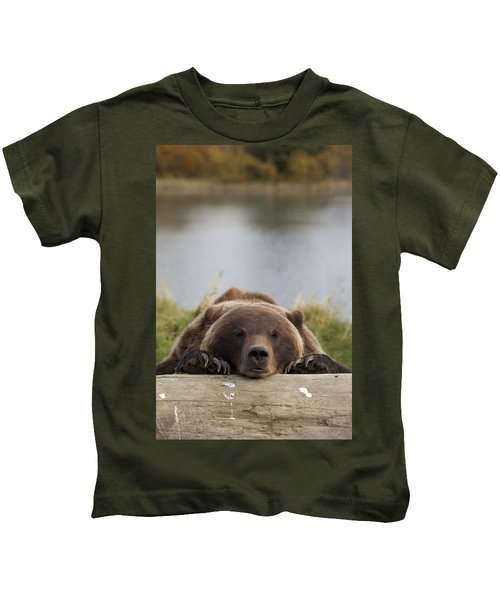 Captive Grizzly Bear Rests Its Head On Kids T-Shirt