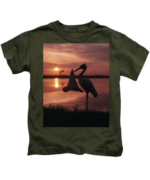 Sunrise Silhouette Of Stork Carrying Kids T-Shirt