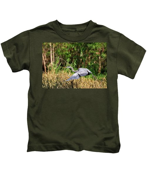 Heron Flying Along The River Bank Kids T-Shirt