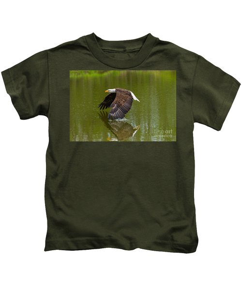 Bald Eagle In Low Flight Over A Lake Kids T-Shirt