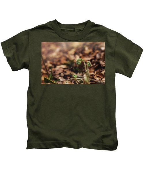 Coiled Fern Among Leaves On Forest Floor Kids T-Shirt