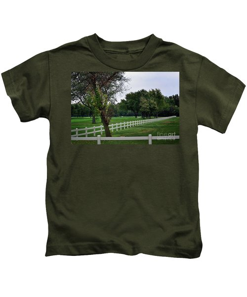 Fence On The Wooded Green Kids T-Shirt