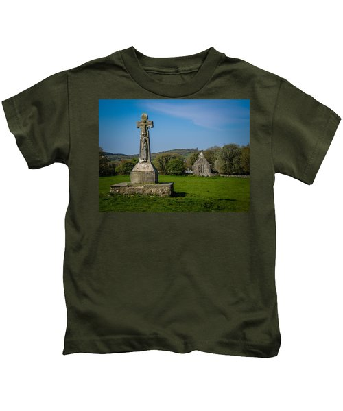 Kids T-Shirt featuring the photograph Medieval High Cross In Irish Pasture by James Truett
