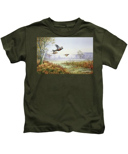 Pheasants In Flight  Kids T-Shirt by Carl Donner
