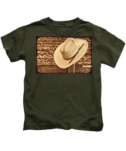 White Cowboy Hat On Fence Kids T-Shirt