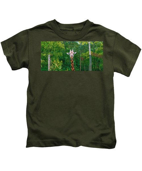Giraffe Looking For Food During The Daytime. Kids T-Shirt