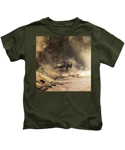 Wildebeest Leaps From The Bank Of The Mara River Kids T-Shirt