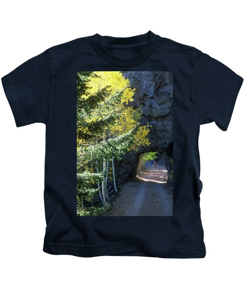 A Young Woman Pedals Her Mountain Bike Kids T-Shirt