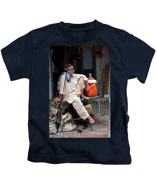 Man Sits And Relaxes In Lahore Walled City Pakistan Kids T-Shirt