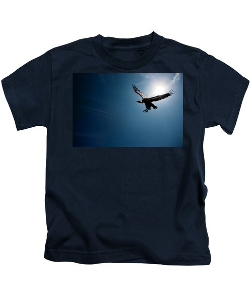 Vulture Flying In Front Of The Sun Kids T-Shirt by Johan Swanepoel