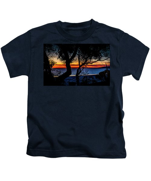 Silhouettes Over Blue Water Kids T-Shirt