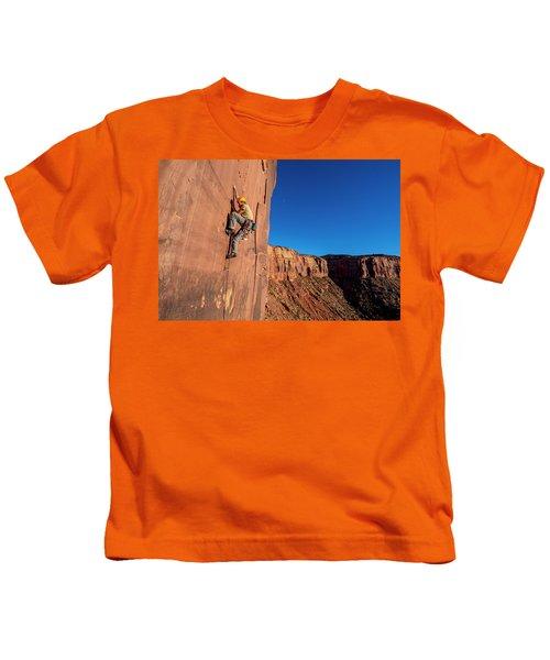 A Man Rock Climbing In Indian Creek Kids T-Shirt