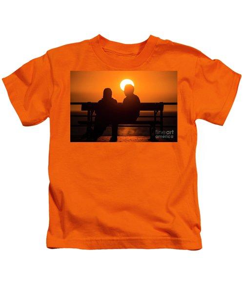 A Couple Sitting At Sunset Kids T-Shirt