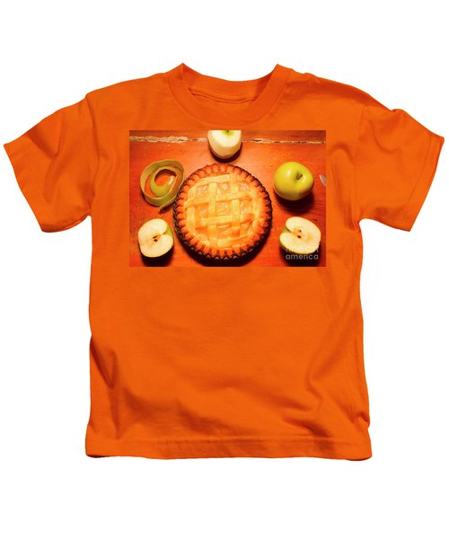 Freshly Baked Pie Surrounded By Apples On Table Kids T-Shirt