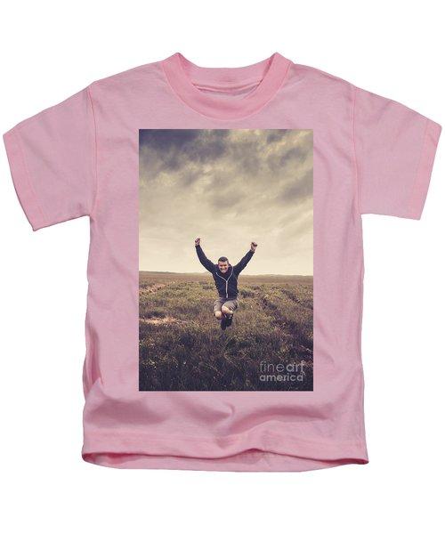 Holiday Man Jumping On Rural Australia Landscape Kids T-Shirt