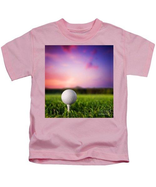 Golf Ball On Tee At Sunset Kids T-Shirt