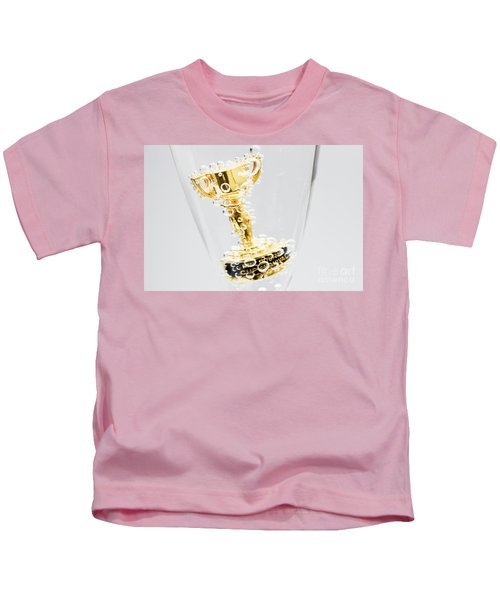Closeup Of Small Trophy In Champagne Flute. Gold Colored Award I Kids T-Shirt